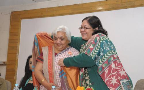 Smt. Lalitha Kumaramangalam, Hon'ble Chairperson, NCW honored social activist Smt. Janak Palta with shawl and shriphal