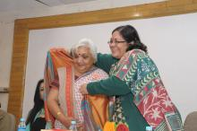 Smt. Lalitha Kumaramangalam, Hon'ble Chairperson, NCW honored social activist Smt. Janak Palta with shawl and shriphal